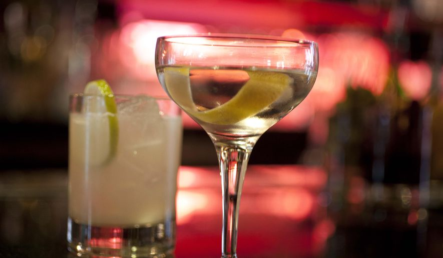 In this Thursday, Dec. 20, 2012, file photo, mixed drinks sit on a hotel bar in San Francisco. (AP Photo/Eric Risberg, File)
