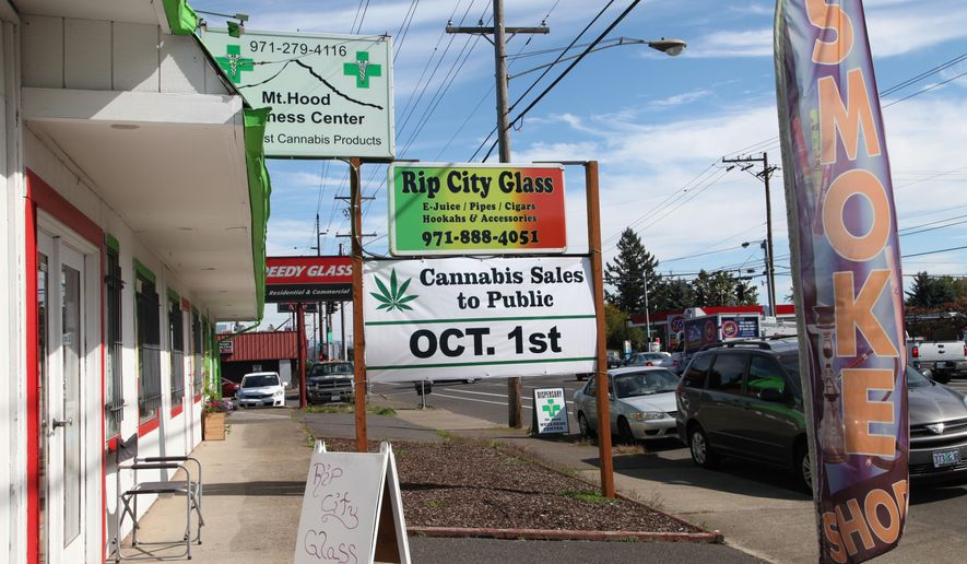A medical marijuana dispensary displays a sign Monday, Sept. 28, 2015, in Portland, Ore. Oregon's medical marijuana dispensaries are getting ready for a watershed moment this week: when recreational pot users will also be able to buy weed at their pot shops. (AP Photo/Gosia Wozniacka)
