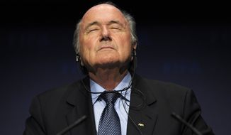 In this Nov. 19, 2010, file photo FIFA President Sepp Blatter pauses during a press conference following a meeting of the Executive Committee in Zurich, Switzerland. On Friday, Sept. 25, 2015, Swiss attorney general opened criminal proceedings against FIFA President Sepp Blatter.   (Steffen Schmidt/Keystone via AP)