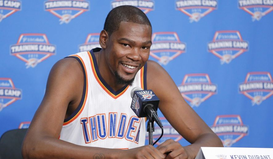 Oklahoma City Thunder forward Kevin Durant smiles as he answers a question during media day in Oklahoma City, Monday, Sept. 28, 2015. (AP Photo/Sue Ogrocki)