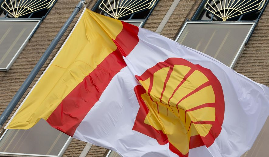 In this Monday, April 7, 2014, file photo, a flag bearing the company logo of Royal Dutch Shell, an Anglo-Dutch oil and gas company, flies outside the head office in The Hague, Netherlands. Royal Dutch Shell will cease exploration in Arctic waters off Alaska's coast following disappointing results from an exploratory well backed by billions in investment and years of work. (AP Photo/Peter Dejong, File)