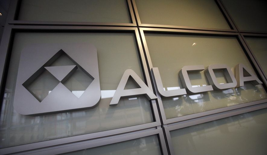 This April 7, 2014, file photo, shows the Alcoa logo in the lobby of Alcoa's headquarters in Pittsburgh. Alcoa announced, Monday, Sept. 28, 2015, it will split into two independent companies by separating its aluminum and automotive metals businesses. (AP Photo/Gene J. Puskar, File)