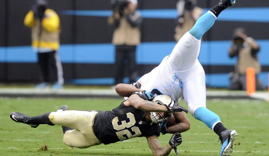 New Orleans Saints' Kenny Vaccaro (32) tackles Carolina Panthers' Mike Tolbert (35) in the first half of an NFL football game in Charlotte, N.C., Sunday, Sept. 27, 2015. (AP Photo/Mike McCarn)
