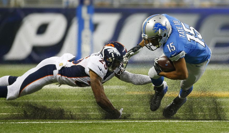 Detroit Lions wide receiver Golden Tate (15) tries pulling away from Denver Broncos cornerback Chris Harris (25) during the first half of an NFL football game, Sunday, Sept. 27, 2015, in Detroit. (AP Photo/Paul Sancya)