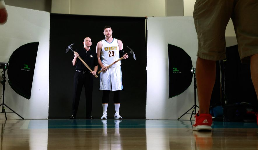 ADDS CITY LOCATION AS DENVER - Denver Nuggets head coach Michael Malone and center Jusuf Nurkic pose for Nuggets team photographer Garrett Ellwood during the team's NBA basketball media day Monday, Sept. 28, 2015 in Denver.  (AP Photo/Jack Dempsey)