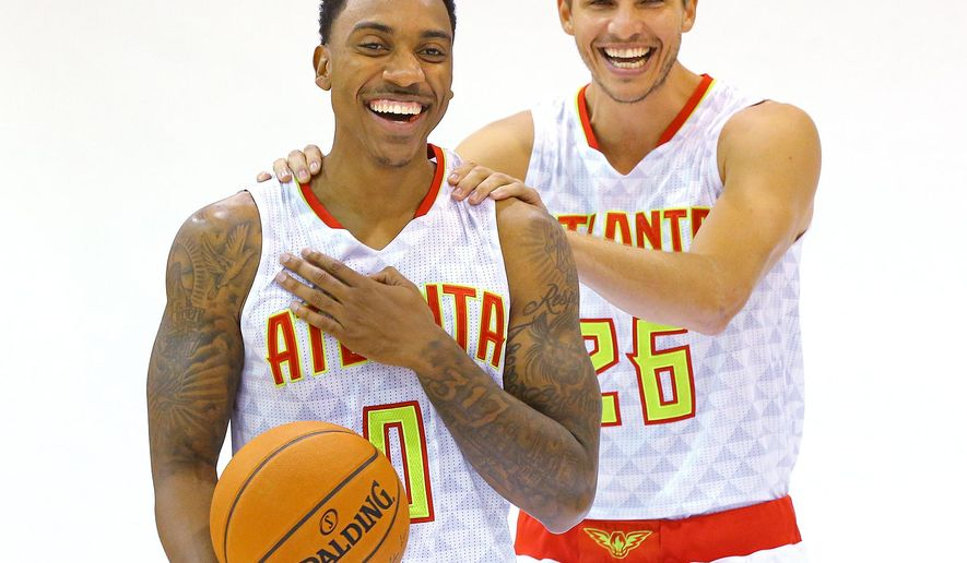 Atlanta Hawks guards Jeff Teague, left, and Kyle Korver laugh between photo shoots during the team's NBA basketball media day Monday, Sept. 28, 2015, in Atlanta. (Curtis Compton/Atlanta Journal-Constitution via AP)  MARIETTA DAILY OUT; GWINNETT DAILY POST OUT; LOCAL TELEVISION OUT; WXIA-TV OUT; WGCL-TV OUT; MANDATORY CREDIT