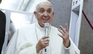 Pope Francis talks to journalists during a press conference he held while en route to Italy, Monday, Sept. 28, 2015. Pope Francis returned to the Vatican Monday at the end of a 10-day trip to Cuba and the United States. (Tony Gentile/Pool Photo via AP) ** FILE **