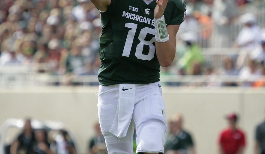 Michigan State's Connor Cook throws a pass against Central Michigan during the second quarter of an NCAA college football game, Saturday, Sept. 26, 2015, in East Lansing, Mich. (AP Photo/Al Goldis)