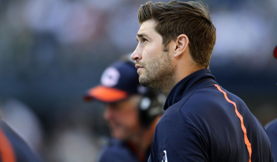 Injured Chicago Bears quarterback Jay Cutler stands on the sidelines in the second half of an NFL football game against the Seattle Seahawks, Sunday, Sept. 27, 2015, in Seattle. (AP Photo/John Froschauer)