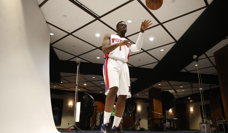 Detroit Pistons' Reggie Jackson passes a ball at a photo session during NBA basketball media day in Auburn Hills, Mich., Monday, Sept. 28, 2015. (AP Photo/Paul Sancya)