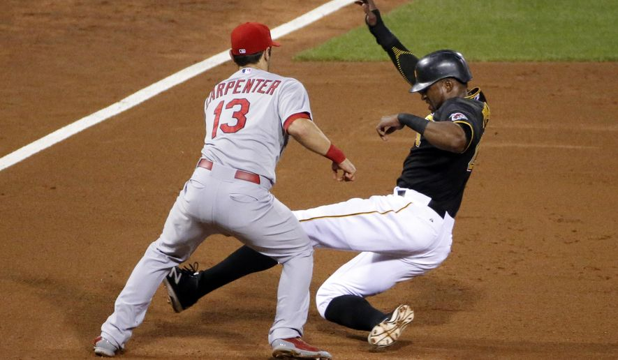St. Louis Cardinals third baseman Matt Carpenter (13) tags out Pittsburgh Pirates' Gregory Polanco during a fielder's choice by Pirates' Josh Harrison in the fifth inning of a baseball game in Pittsburgh, Monday, Sept. 28, 2015. (AP Photo/Gene J. Puskar)
