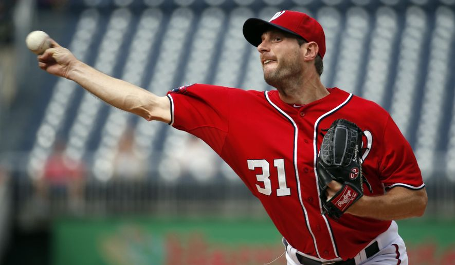 Washington Nationals starting pitcher Max Scherzer throws during the first inning of a baseball game against the Cincinnati Reds at Nationals Park, Monday, Sept. 28, 2015, in Washington. (AP Photo/Alex Brandon)