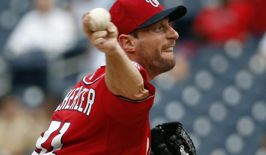 Washington Nationals starting pitcher Max Scherzer throws during the third inning of a baseball game against the Cincinnati Reds at Nationals Park, Monday, Sept. 28, 2015, in Washington. (AP Photo/Alex Brandon)