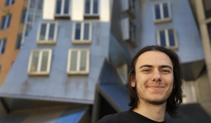 In this Thursday, Sept. 24, 2015 photo, Massachusetts Institute of Technology student Jeremy Rubin stands outside the Ray and Maria Stata Center, where offices for the Computer Science and Artificial Intelligence Laboratory are located on the MIT campus, in Cambridge, Mass. Following a controversy from the development of a computer program called Tidbit, led by Rubin, that would have given websites a new way to make money without online ads, MIT is partnering with Boston University's law school to open a free legal clinic for campus entrepreneurs. (AP Photo/Steven Senne)
