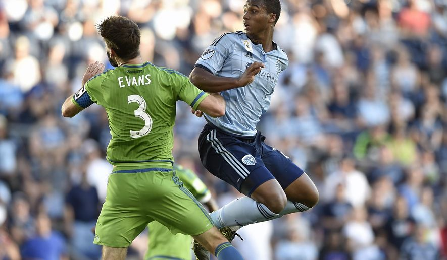 Seattle's Brad Evans (3) and Sporting Kansas City's Erik Palmer-Brown look back to see if Palmer-Brown's header went into the goal during an MLS soccer game at Sporting Park, Sunday, Sept. 27, 2015. Sporting and Seattle tied 1-1. (Jill Toyoshiba/The Kansas City Star via AP)