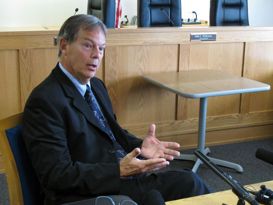 """David Pratt, the assistant director for transportation safety at the Washington state Utilities and Transportation Commission, talks to members of the media Monday, Sept. 28, 2015, in Olympia, Wash., after the commission suspended the operations of a Seattle tour company, pending a review following a deadly crash that involved a repurposed military """"duck boat."""" (AP Photo/Rachel La Corte)"""