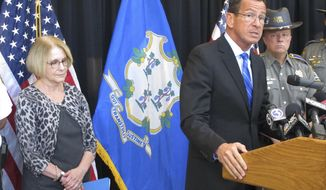 Connecticut Gov. Dannel P. Malloy, front right, discusses a decrease over the previous year in violent crime in the state, Monday, Sept. 28, 2015, in Middletown, Conn. Malloy is joined Dora Schriro, left, commissioner of the state Department of Emergency Services and Public Protection, and Col. Brian Meraviglia of the Connecticut State Police. (AP Photo/Dave Collins)