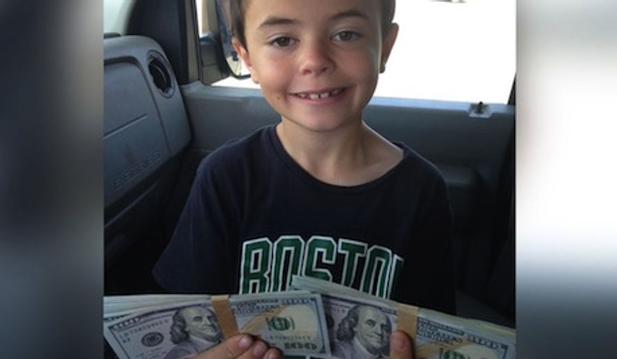 Aiden Wright, 7, has found himself $100 richer after he did the right thing and turned in $8,000 that he found Saturday at the top of a playground slide. (ABC News via Danny Wright)