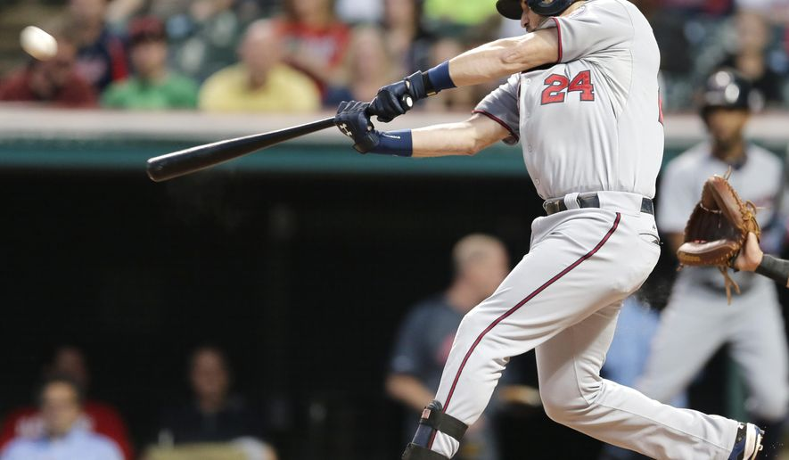 Minnesota Twins' Trevor Plouffe hits a two-run home run off Cleveland Indians starting pitcher Corey Kluber in the first inning of a baseball game, Monday, Sept. 28, 2015, in Cleveland. Miguel Sano scored on the play. (AP Photo/Tony Dejak)
