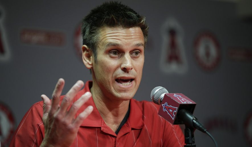 FILE - In this April 3, 2015 file photo, Los Angeles Angels General Manager Jerry Dipoto speaks to reporters during a news conference in Anaheim, Calif.  The Seattle Mariners have found their new general manager, hiring former Angels GM Jerry Dipoto. Seattle announced Dipoto's hiring Monday, Sept. 28, 2015. He replaces Jack Zduriencik, who was fired in late August after seven disappointing seasons during which the club failed to end its playoff drought. (AP Photo/Jae C. Hong)