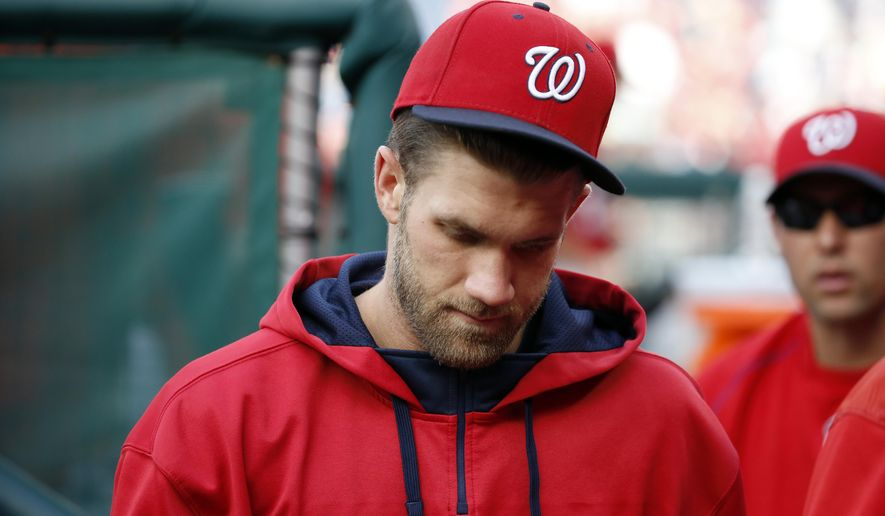 Washington Nationals right fielder Bryce Harper walks in the dugout during a baseball game against the Cincinnati Reds at Nationals Park, Monday, Sept. 28, 2015, in Washington. Harper was held from the lineup after his altercation with relief pitcher Jonathan Papelbon. The Nationals won 5-1. (AP Photo/Alex Brandon)