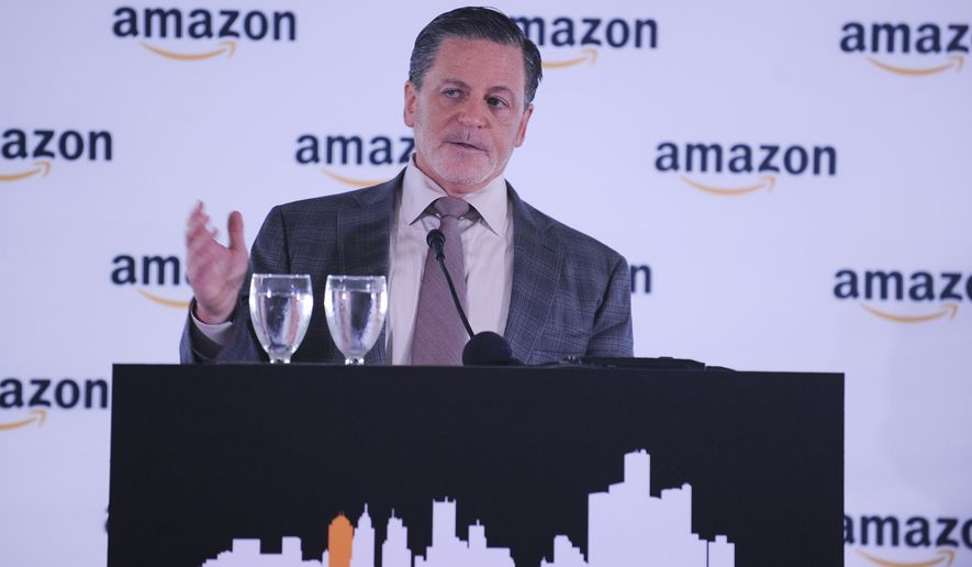 Dan Gilbert, chairman and founder of Quicken Loans, speaks about on the Amazon announcement Monday, Sept. 28, 2015 in Detroit. Amazon on Monday announced the unveiling of its corporate office in Detroit. Amazon has hundreds of employees across the state of Michigan and is in the process of building the downtown Detroit office into a growing technology hub. (Clarence Tabb, Jr./The Detroit News via AP)