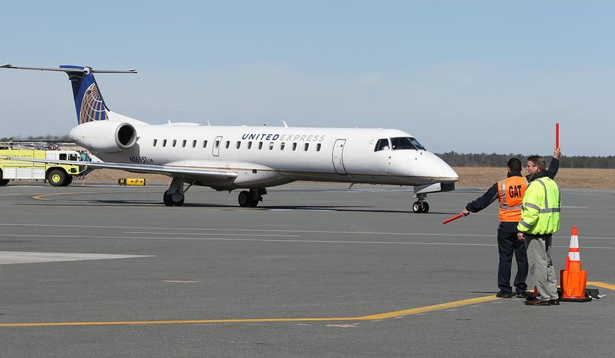 In this April 1, 2014 photo, the first United Airlines flight arrives at the Atlantic City International Airport in Egg Harbor Township, N.J. According to the Bureau of Transportation Statistics, the two 50-seat jets used by United were averaging just 26 passengers a day and was canceled in December 2014. (Michael Ein/The Press of Atlantic City via AP)