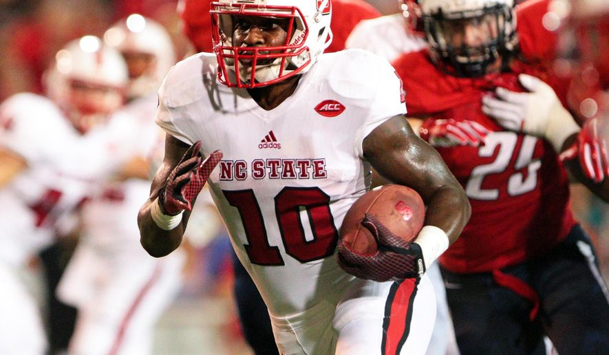North Carolina State running back Shadrach Thornton (10) carries for a touchdown against South Alabama during the first half of an NCAA college football game Saturday, Sept. 26, 2015, in Mobile, Ala.(Mike Kittrell/AL.com via AP)