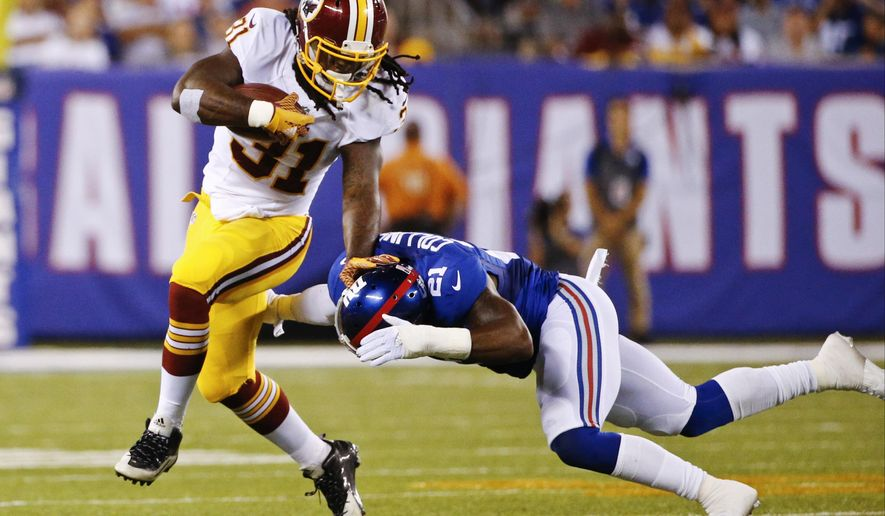 FILE - In this Sept. 24, 2015 file photo, Washington Redskins running back Matt Jones (31) stiff arms New York Giants' Landon Collins (21) during the first half an NFL football game in East Rutherford, N.J.  Coach Jay Gruden and the Redskins get back to work Monday, Sept. 28, hoping to fix all of their problems before hosting NFC East rival Philadelphia next weekend. Coverage by freelancer Ian Quillen.(AP Photo/Kathy Willens)