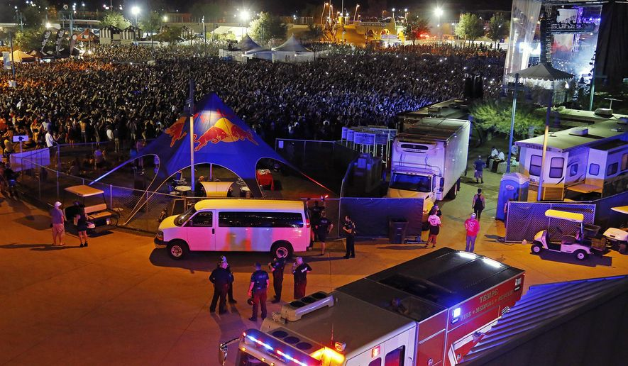 Fire units and ambulances line up to transport injured concert goers at Tempe Beach Park Saturday, Sept. 26, 2015 in Tempe, Ariz. An Arizona music festival is set to resume for a Kanye West performance after as many as 12 people were injured when a crowd rushed a stage, officials said Sunday. (David Kadlubowski/The Arizona Republic via AP)  MARICOPA COUNTY OUT; MAGS OUT; NO SALES; MANDATORY CREDIT