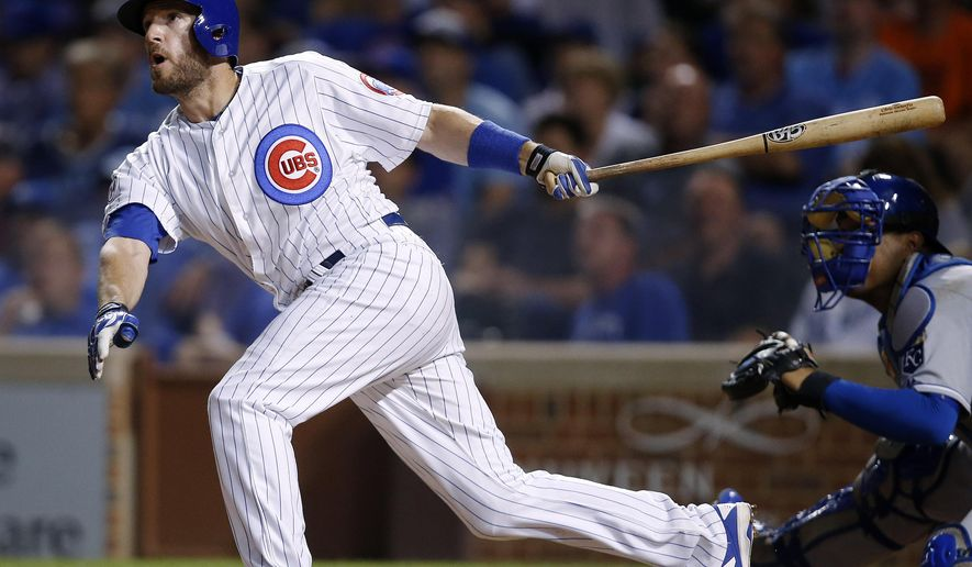 Chicago Cubs' Chris Denorfia connects for a walk-off home run against the Kansas City Royals during the 11th inning of a baseball game Monday, Sept. 28, 2015, in Chicago. The Cubs won 1-0 in 11 innings. (AP Photo/Andrew A. Nelles)