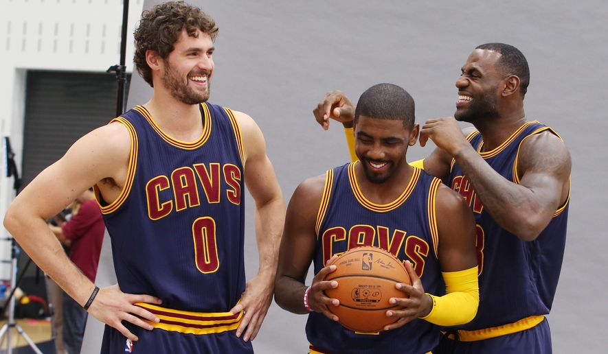 Cleveland Cavaliers' Lebron James, right, Kyrie Irving, center, and Kevin Love joke around during portraits during the NBA team's media day, Monday, Sept. 28, 2015, in Independence, Ohio. (AP Photo/Ron Schwane)
