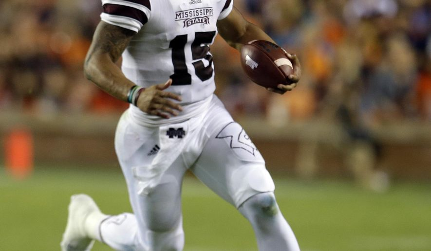 Mississippi State quarterback Dak Prescott scrambles for a first down during the second half of an NCAA college football game against Auburn, Saturday, Sept. 26, 2015, in Auburn, Ala. (AP Photo/Butch Dill)