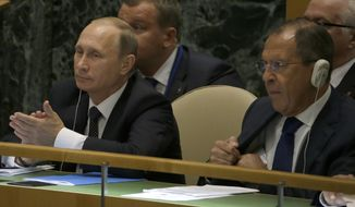 Russian President Vladimir Putin, left, and Foreign Minister Sergei Lavrov listen as Chinese President Xi Jinping addresses the 70th session of the United Nations General Assembly at U.N. headquarters, Monday, Sept. 28, 2015. (AP Photo/Mary Altaffer)