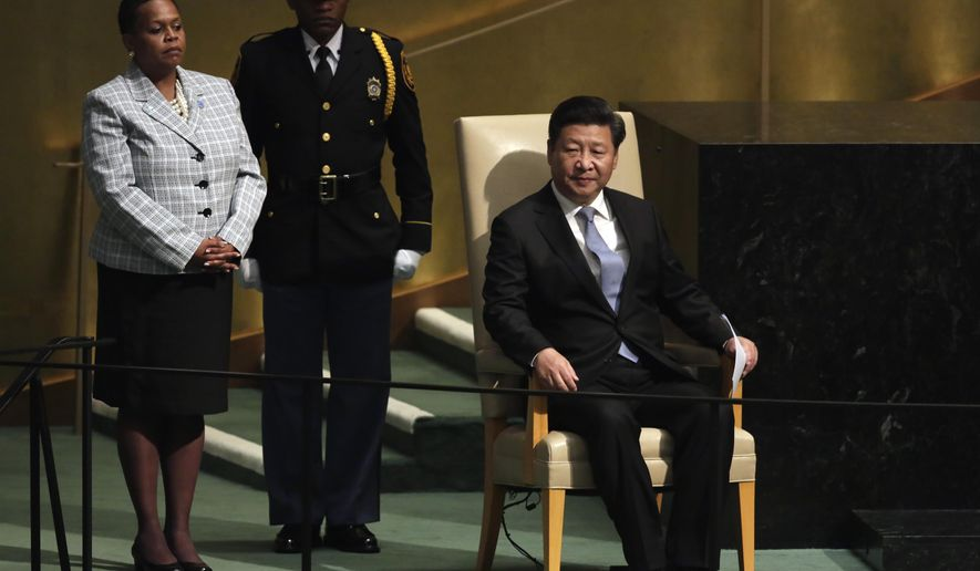 China's President Xi Jinping listens to applause after his address to the 70th session of the United Nations General Assembly, Monday, Sept. 28, 2015. (AP Photo/Richard Drew)