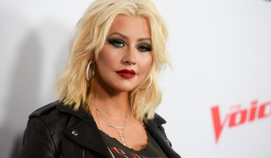 "FILE - In this April 23, 2015 file photo, Christina Aguilera arrives at Season 8 of ""The Voice"" Red Carpet Event in West Hollywood, Calif. Aguilera was on a humanitarian trip in Ecuador last week filming a new PSA for Yum! Brands World Hunger Relief effort that raises awareness, volunteerism and funds for WFP and other hunger relief agencies.  (Photo by Richard Shotwell/Invision/AP, File)"