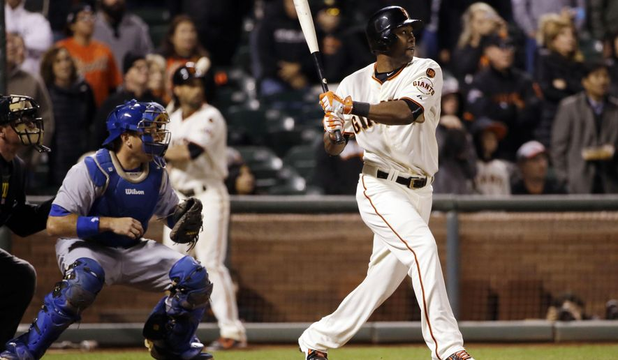 San Francisco Giants' Alejandro De Aza drives in a run with a sacrifice fly ball to win the game 3-2 in the 12th inning of a baseball game against the Los Angeles Dodgers Monday, Sept. 28, 2015, in San Francisco. (AP Photo/Marcio Jose Sanchez)