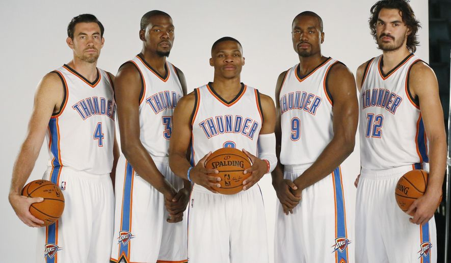 Oklahoma City Thunder players, from left, Nick Collison, Kevin Durant, Russell Westbrook, Serge Ibaka and Steven Adams pose for a photo during media day in Oklahoma City, Monday, Sept. 28, 2015. (AP Photo/Sue Ogrocki)