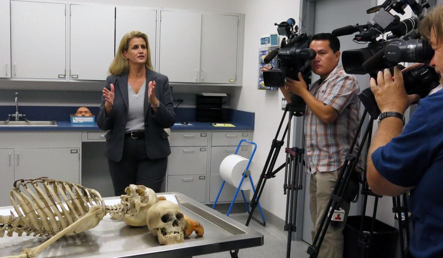 Tiffany Williams, senior deputy coroner in Orange County, speaks with reporters about an upcoming event to help identify missing persons at the California Coroner Training Center in Santa Ana, Calif., Tuesday, Sept. 29, 2015. The goal is to encourage relatives of the missing to bring photographs and dental records of their loved ones and provide their own DNA samples to help try to find a match among unidentified remains. (AP Photo/ Amy Taxin)
