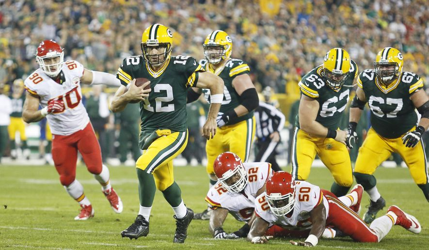 Green Bay Packers' Aaron Rodgers runs during the first half of an NFL football game against the Kansas City Chiefs Monday, Sept. 28, 2015, in Green Bay, Wis. (AP Photo/Matt Ludtke)