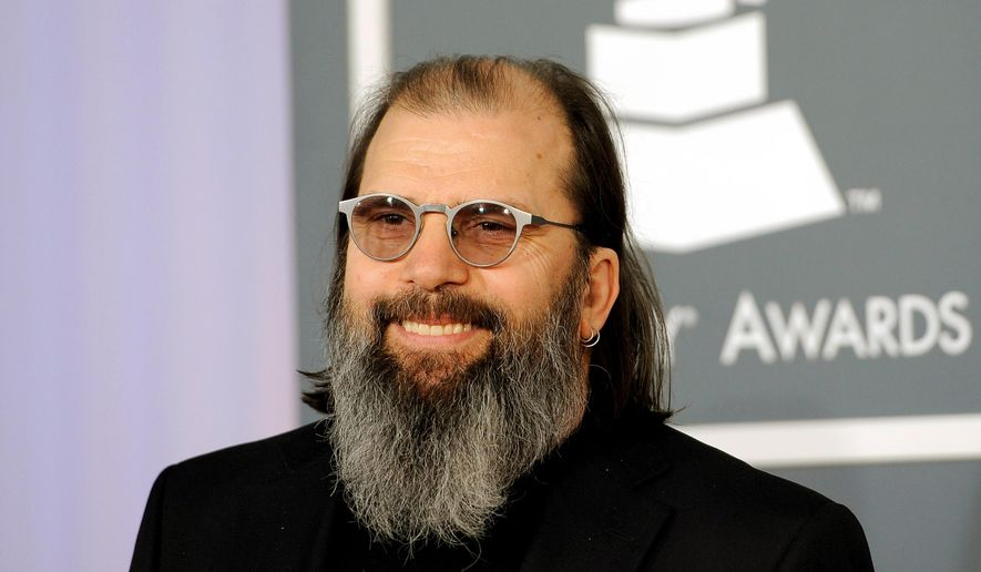 """FILE - In this Feb. 12, 2012 file photo, Steve Earle arrives at the 54th annual GRAMMY Awards in Los Angeles. Earle said it was important to have a Southern voice on his new protest song """"Mississippi it's Time,""""urging Mississippi to change its state flag to remove the Confederate battle emblem. (AP Photo/Chris Pizzello, File)"""