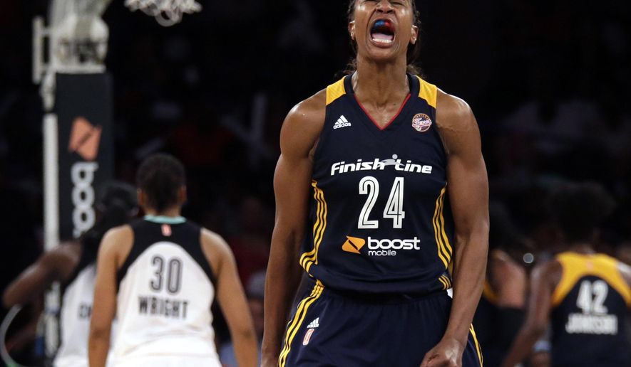 Indiana Fever forward Tamika Catchings (24) reacts against the New York Liberty during the second half in Game 3 of the WNBA basketball Eastern Conference finals at Madison Square Garden in New York, Tuesday, Sept. 29, 2015. The Fever defeated the Liberty and will take on the Minnesota Lynx in the WNBA finals. (AP Photo/Adam Hunger)