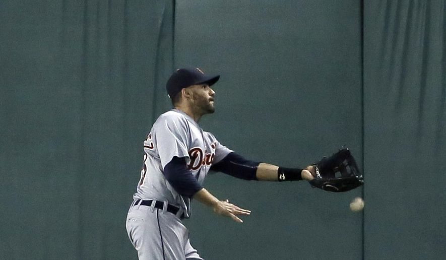 Detroit Tigers right fielder J.D. Martinez is unable to reach a ball hit for a double by Texas Rangers' Adrian Beltre in the fourth inning of a baseball game Tuesday, Sept. 29, 2015, in Arlington, Texas. (AP Photo/Tony Gutierrez)