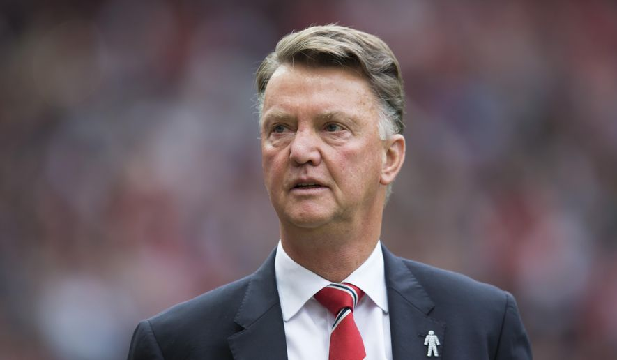 Manchester United's manager Louis van Gaal takes to the touchline before the English Premier League soccer match between Manchester United and Sunderland at Old Trafford Stadium, Manchester, England, Saturday, Sept. 26, 2015. (AP Photo/Jon Super)