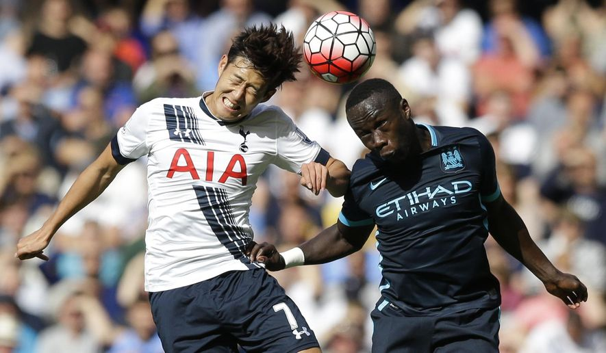 Tottenham Hotspur's Son Heung-min competes for the ball with Manchester City's Bacary Sagna during the English Premier League soccer match between Tottenham Hotspur and Manchester City at White Hart Lane stadium in London, Saturday, Sept. 26, 2015.  (AP Photo/Matt Dunham)