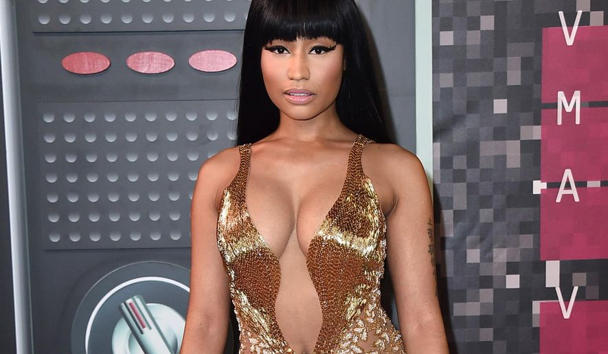 In this Aug. 30, 2015 file photo, Nicki Minaj arrives at the MTV Video Music Awards at the Microsoft Theater in Los Angeles. ABC Family said Tuesday, Sept. 29, that Ms. Minaj will produce and appear in a new scripted comedy series for the cable channel. The sitcom will be based on her family's move from Trinidad to the United States and her development as an artist growing up in Queens, N.Y., the channel said. It will be shot in Queens this winter. (Photo by Jordan Strauss/Invision/AP, File)