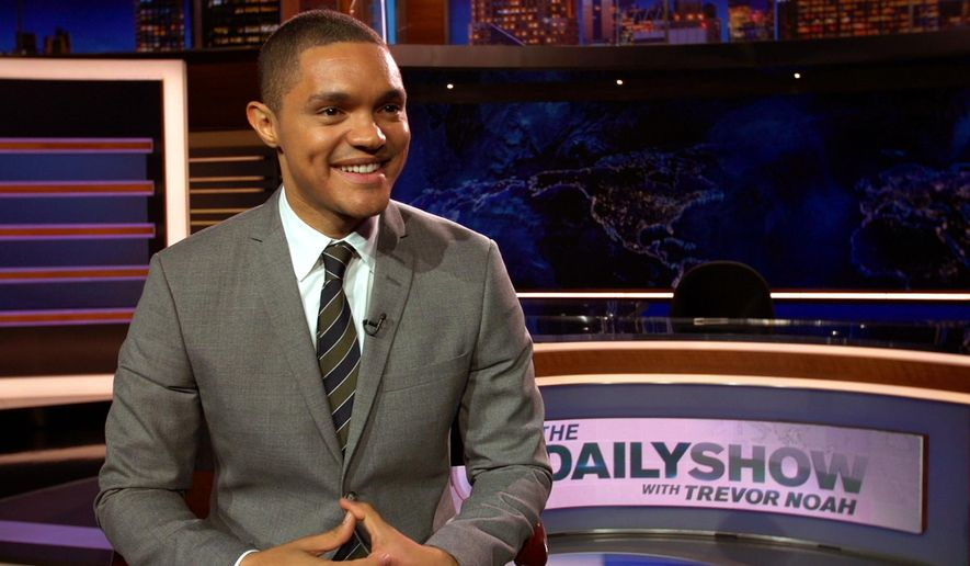 "In this Sept. 25, 2015 image taken from video, Trevor Noah appears on the set of his new show, ""The Daily Show with Trevor Noah,"" in New York. Noah takes over for Jon Stewart on Monday. (AP Photo)"