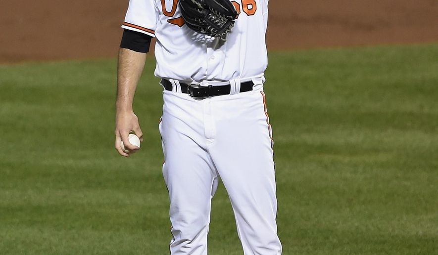 Baltimore Orioles pitcher Darren O'Day pauses on the mound after the Toronto Blue Jays score twice to tie the baseball game in the eighth inning, Monday, Sept. 28, 2015, in Baltimore. The Blue Jays won 4-3. (AP Photo/Gail Burton)