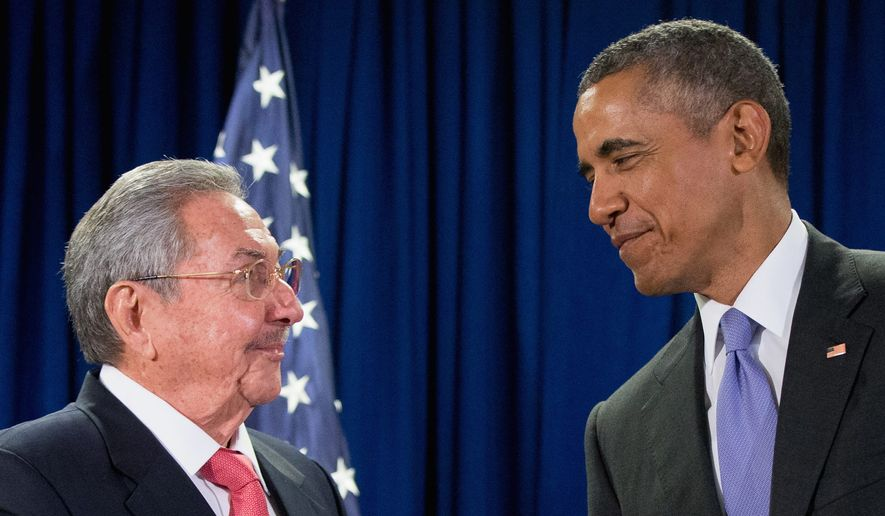 President Obama talks with Cuban President Raul Castro before a bilateral meeting, Tuesday at the United Nations headquarters in New York. (Associated Press)