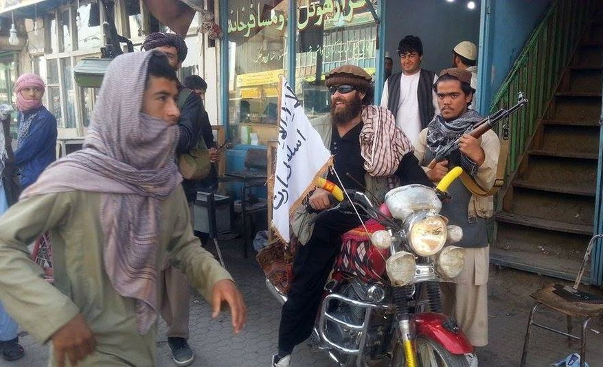 A Taliban fighter sits on his motorcycle adorned with a Taliban flag in a street in Kunduz city, north of Kabul, Afghanistan, Tuesday, Sept. 29, 2015. The U.S. military carried out an airstrike on Tuesday on the northern Afghan city of Kunduz, which was captured by the Taliban the previous day in a major setback to the government of Afghan President Ashraf Ghani. (AP Photo)